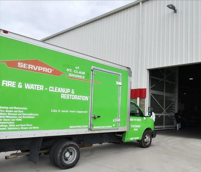SERVPRO truck in front of large commercial building