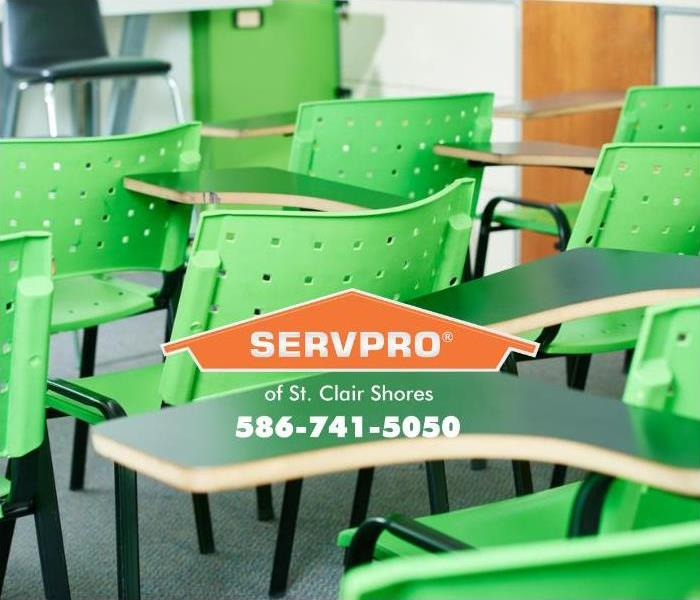 A classroom with bright green chairs sits empty, waiting for the next SERVPRO continuous education session to start.
